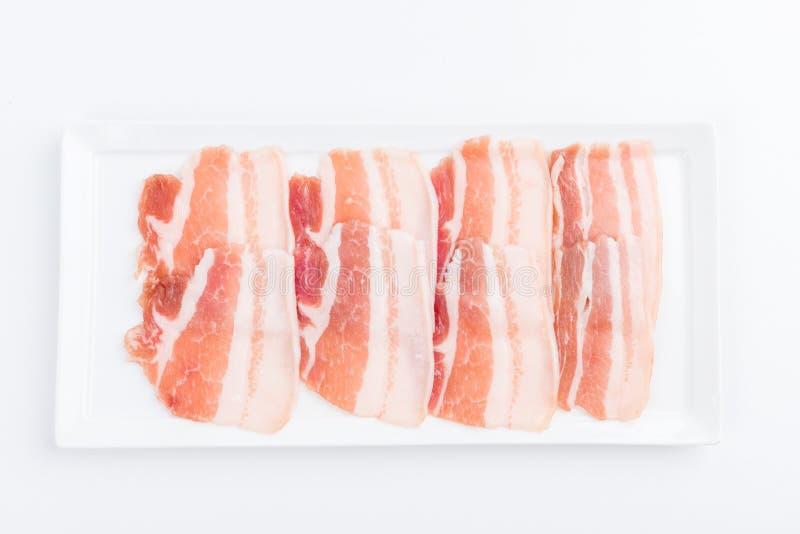 Fresh pork sliced for japanese hot pot. On white background royalty free stock images