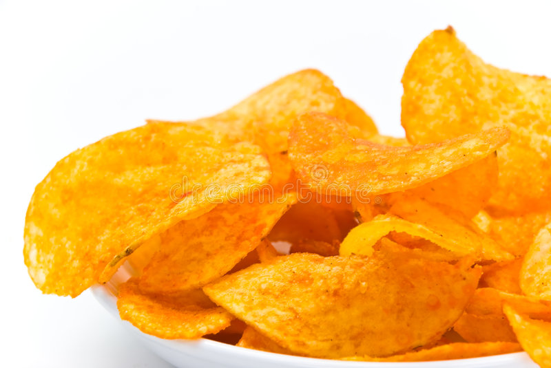 Fresh potato chips with red pepper.  royalty free stock photo