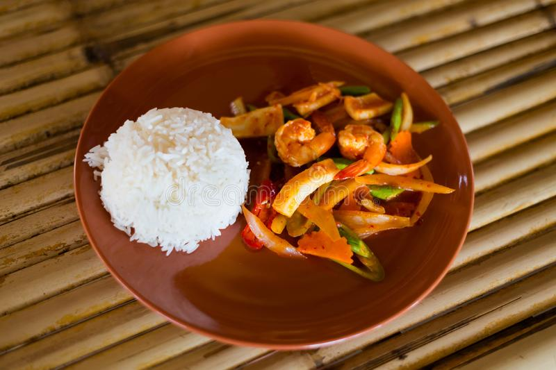Thai red curry paste seafood. Fresh prepared asian spicy red curry paste seafood mix served with jasmine rice in local restaurant on Koh Lanta island stock photos
