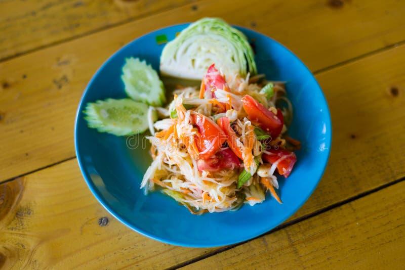 Thai Som Tam papaya salad. Fresh prepared asian spicy Som Tam papaya salad with cabbage and cucumber served in local restaurant on Koh Mook island. Traditional royalty free stock images