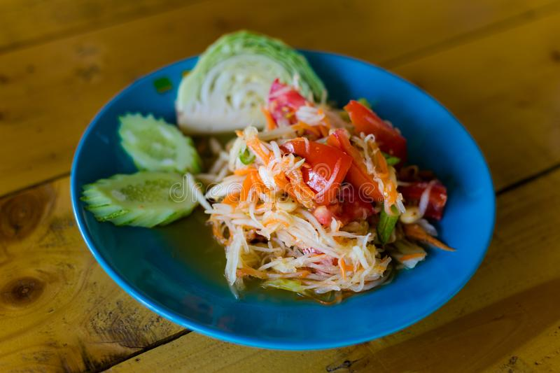 Thai Som Tam papaya salad. Fresh prepared asian spicy Som Tam papaya salad with cabbage and cucumber served in local restaurant on Koh Mook island. Traditional royalty free stock photo
