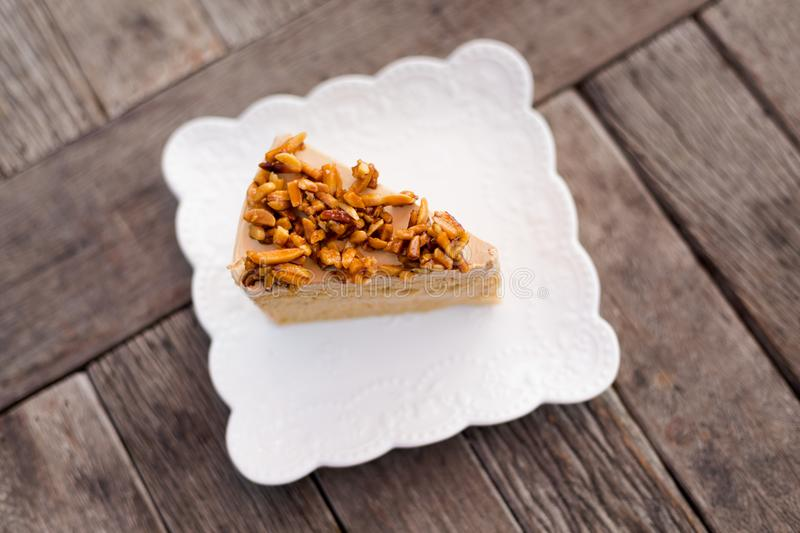 Piece of thai coffee cake. Fresh prepared slice of asian almond coffee cake served in local restaurant. Traditional thai sweets made of fresh ingredients stock images