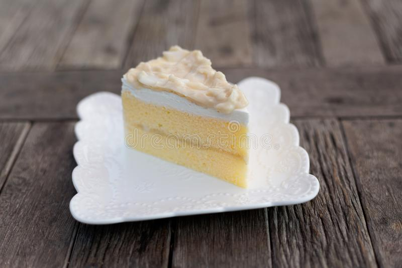 Piece of thai coconut cake. Fresh prepared slice of asian coconut cake served in local restaurant. Traditional thai sweets made of fresh ingredients stock photos