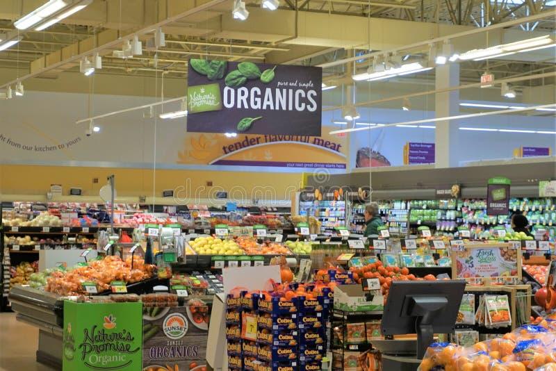 Fresh produce isle in supermarket royalty free stock photography