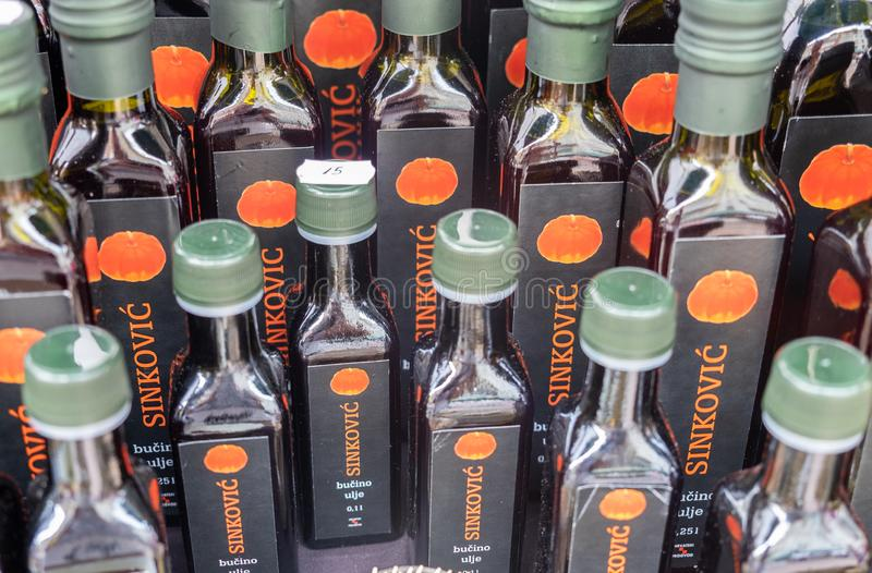 Fresh pumpkin seed oil on sale at street market in Rijeka town stock image