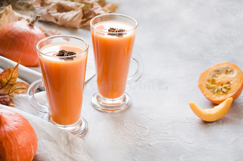 Fresh pumpkin smoothie or juice. Autumn, fall or winter hot drink. Cozy healthy beverage. Fresh pumpkin spice smoothie or juice on dark. Autumn, fall or winter royalty free stock photos