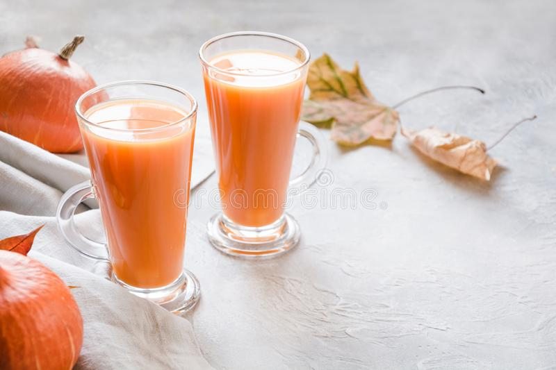 Fresh pumpkin smoothie or juice. Autumn, fall or winter hot drink. Cozy healthy beverage. Fresh pumpkin spice smoothie or juice on dark. Autumn, fall or winter royalty free stock image