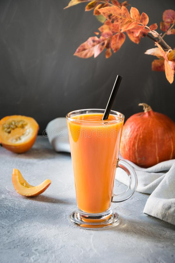 Fresh pumpkin smoothie or juice on dark. Autumn, fall or winter hot drink. Cozy healthy beverage. Fresh pumpkin spice smoothie or juice on dark. Autumn, fall or stock images