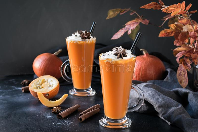 Fresh pumpkin smoothie or juice on dark. Autumn, fall or winter hot drink. Cozy healthy beverage. Fresh pumpkin spice smoothie or juice on dark. Autumn, fall or royalty free stock image