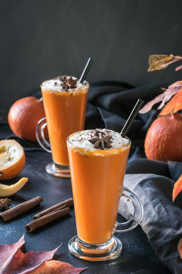 Fresh pumpkin smoothie or juice on dark. Autumn, fall or winter hot drink. Cozy healthy beverage. Fresh pumpkin spice smoothie or juice on dark. Autumn, fall or royalty free stock photo