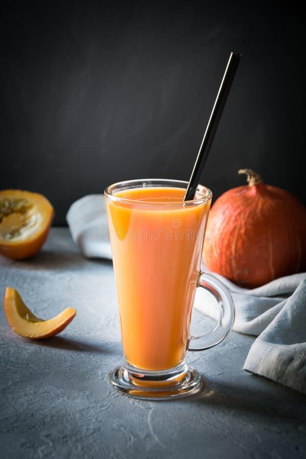 Fresh pumpkin spice smoothie or juice on dark. Autumn, fall or winter hot drink on dark. Cozy healthy beverage. Fresh pumpkin spice smoothie or juice on dark stock photos