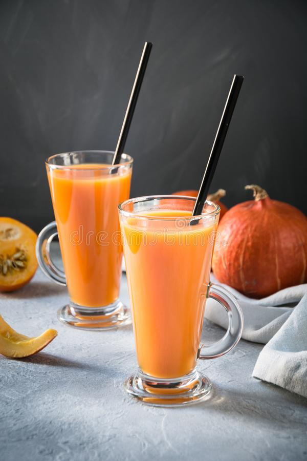 Fresh pumpkin spice smoothie or juice on dark. Autumn, fall or winter hot drink on dark. Cozy healthy beverage. Fresh pumpkin spice smoothie or juice on dark royalty free stock images