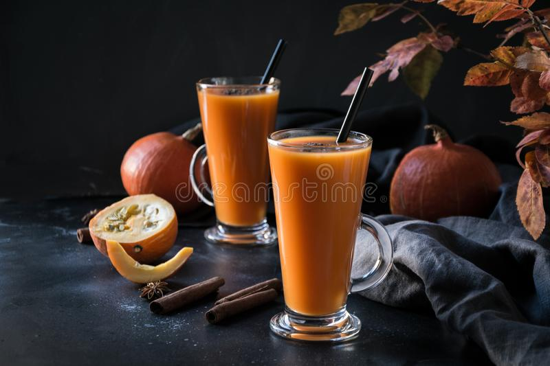 Fresh pumpkin spice smoothie or juice on dark. Autumn, fall or winter hot drink on dark. Cozy healthy beverage. Fresh pumpkin spice smoothie or juice on dark royalty free stock photography
