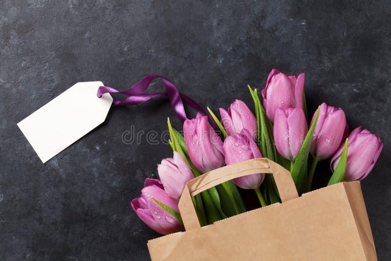 Fresh purple tulip flowers bag stock images