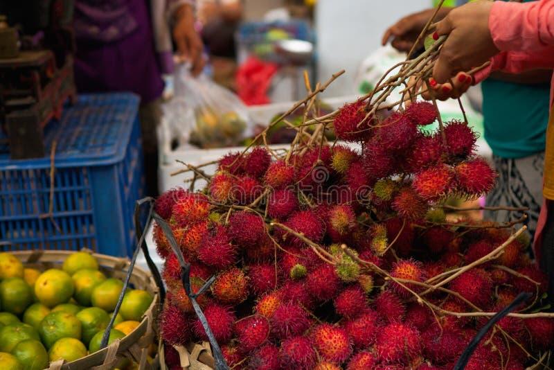 Fresh rambutan fruits in a local market in Bali. Fresh exotic tropical rambutan fruits in a local market in Ubud village, Bali island, Indonesia stock photos