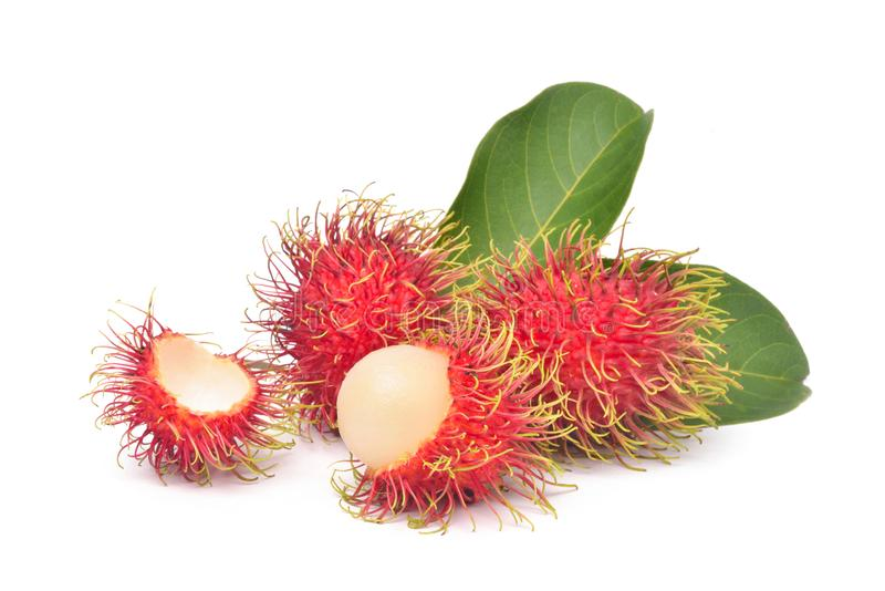 Fresh Rambutan with green leaves royalty free stock photos