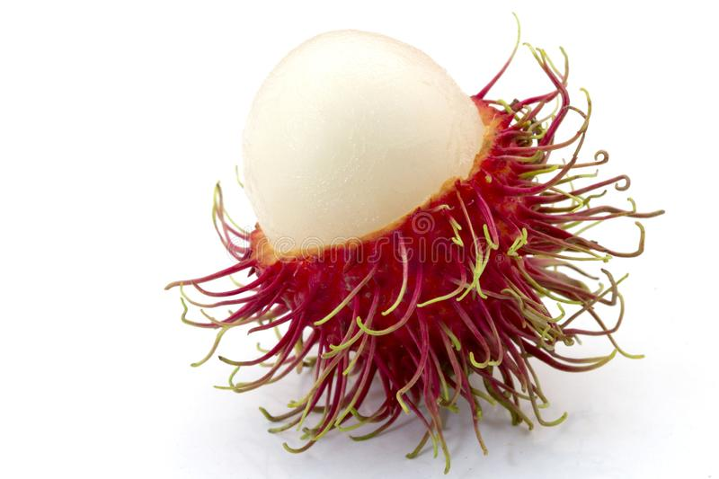Fresh Rambutan with green leaves isolated on white background stock images