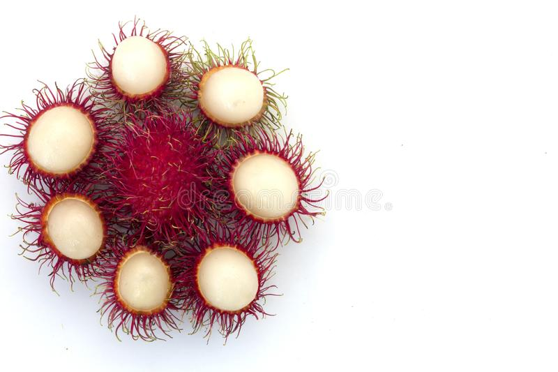 Fresh Rambutan with green leaves isolated on white background stock photos