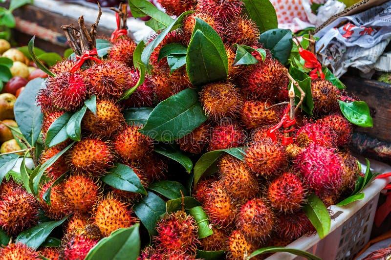 Fresh rambutans is known of Rambutan Gula Batu on basket. Organic raw rambutans with leaf is a tropical fruit, sweet stock images
