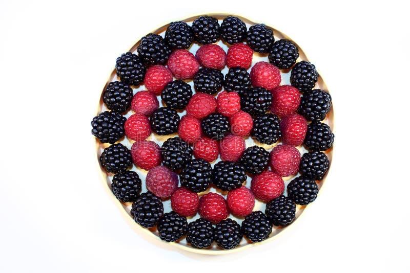 Fresh raspberries and blackberries royalty free stock image