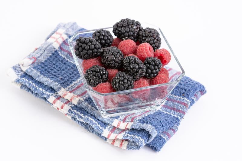 Fresh Raspberries and Blackberries in the bowl royalty free stock images