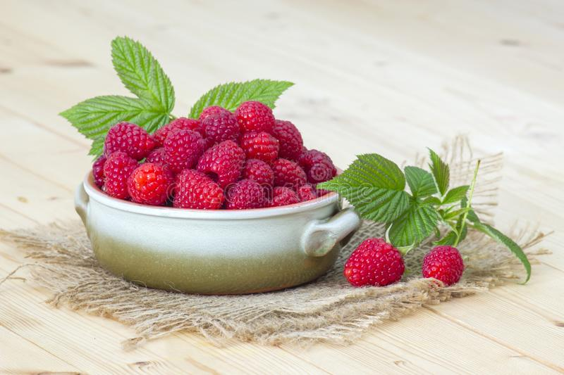 Fresh raspberries in a bowl royalty free stock image