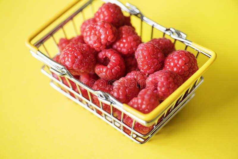Fresh raspberries in a mini basket royalty free stock photo