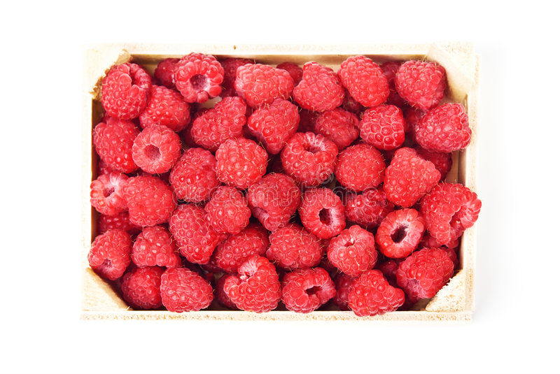 Fresh raspberries in a wooden box royalty free stock image