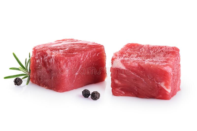 Fresh raw beef cubes pepper and rosemary stock images