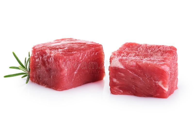 Fresh raw beef cubes and rosemary royalty free stock image