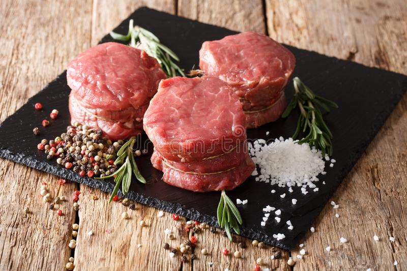 fresh raw beef fillet mignon on old wooden background. Horizontal stock photos
