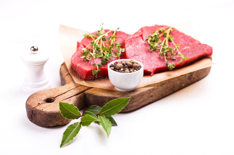 Fresh raw beef tenderloin and marbled steaks with seasoning royalty free stock photos