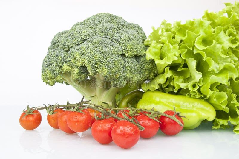 Fresh Raw Broccoli, Cheery tomatoes stock images
