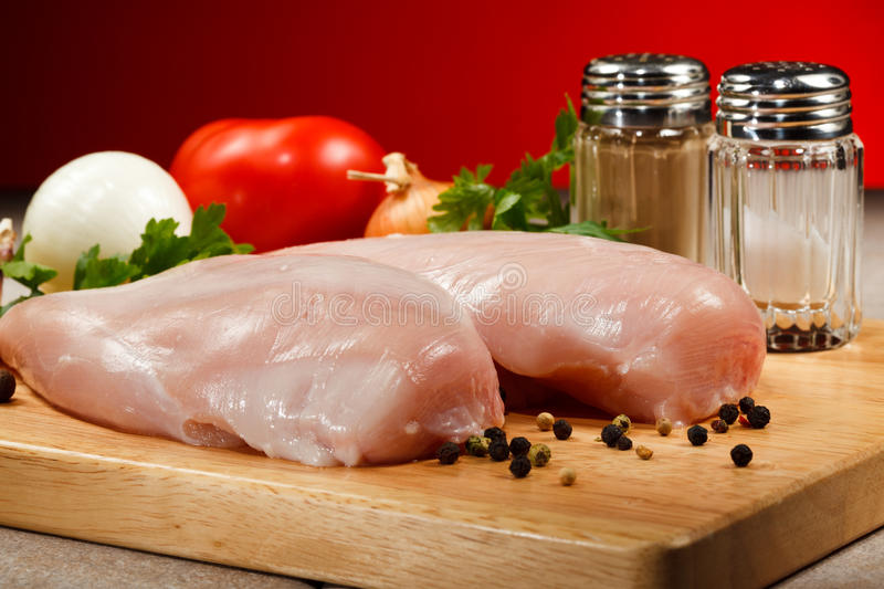 Fresh raw chicken breasts stock photo