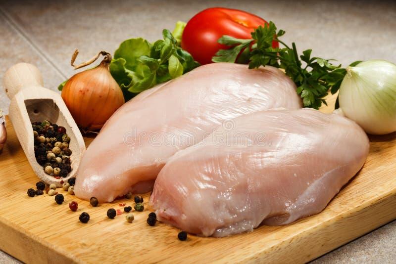 Fresh raw chicken breasts. On cutting board stock image