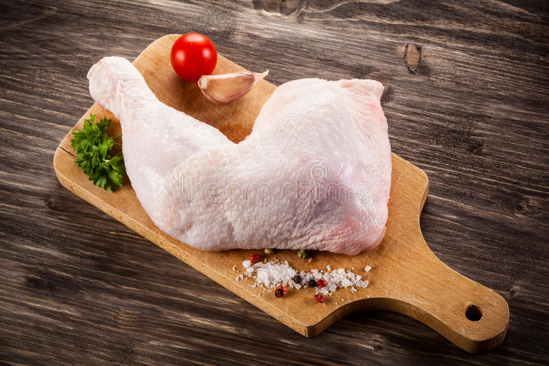 Fresh raw chicken leg royalty free stock photography