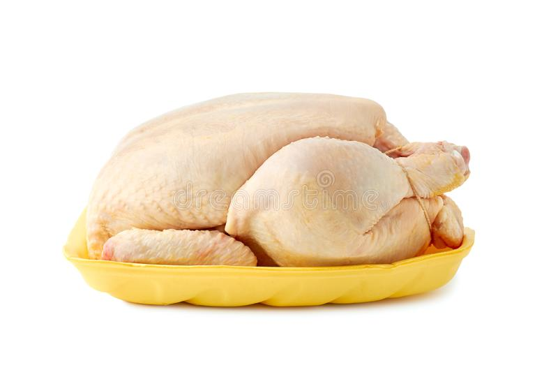 Fresh raw chicken on retail tray over white royalty free stock photos
