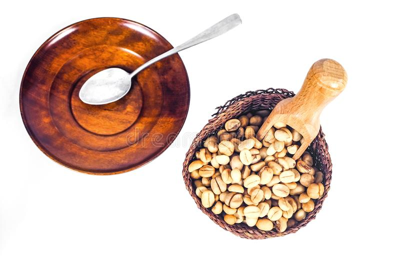 Fresh Raw coffee beans in wood dish on white. Background stock photography