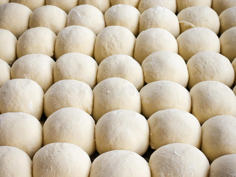 Fresh raw dough balls background, trendy seamless pattern from b stock photo