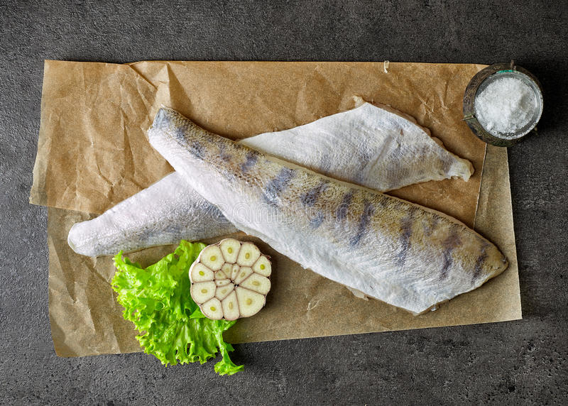 Fresh raw fish fillets. Fresh raw perch fish fillets on baking paper, top view royalty free stock photo