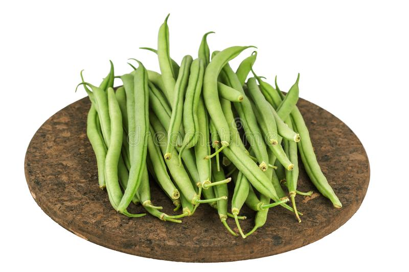 Fresh raw green beans on board isolated on white stock image