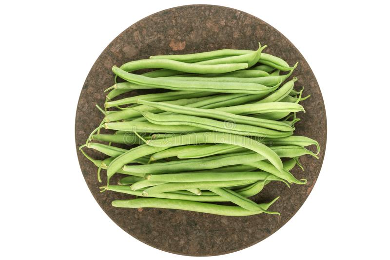 Fresh raw green beans on board isolated on white. Top view stock image