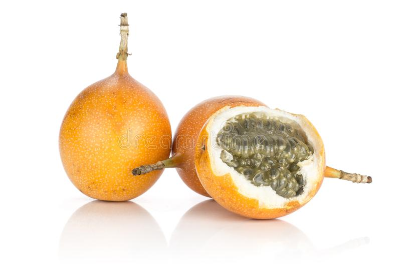 Fresh Raw Grenadilla passionfruit isolated on white. Three giant grenadilla one split with juicy flesh and seeds isolated on white background sweet yellow stock image