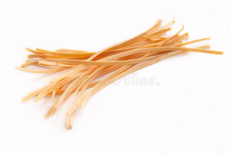 Fresh raw homemade Italian pasta isolated stock photos