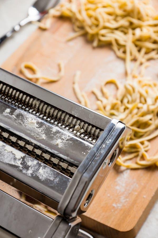 Fresh raw homemade pasta fettuccine royalty free stock photography