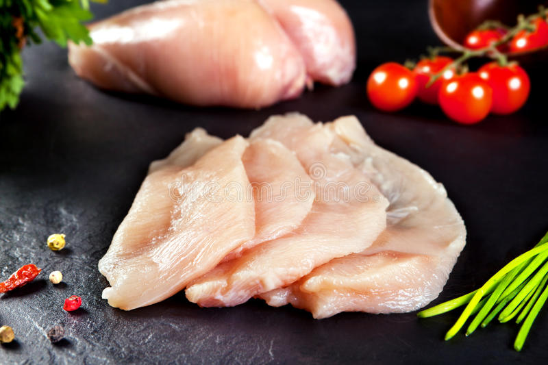 Fresh and raw meat. Chicken breast fillets cut ready for cooking royalty free stock images