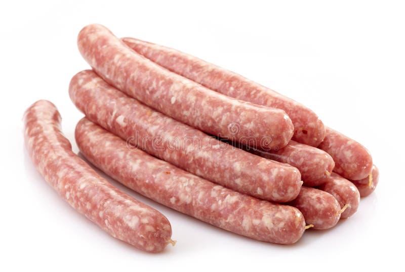Fresh raw meat sausages stock photos