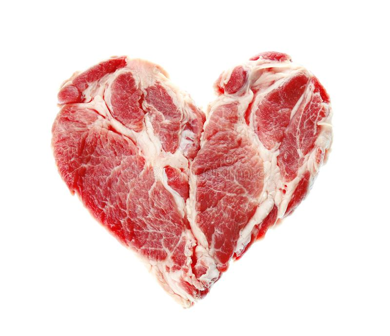 Fresh raw meat in shape of heart. On white background stock photo