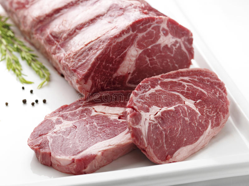 Fresh Raw meat. On white plate stock photos