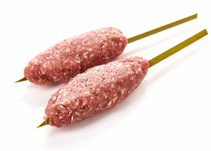 Fresh raw minced meat skewers kebabs. Isolated on white background stock photography